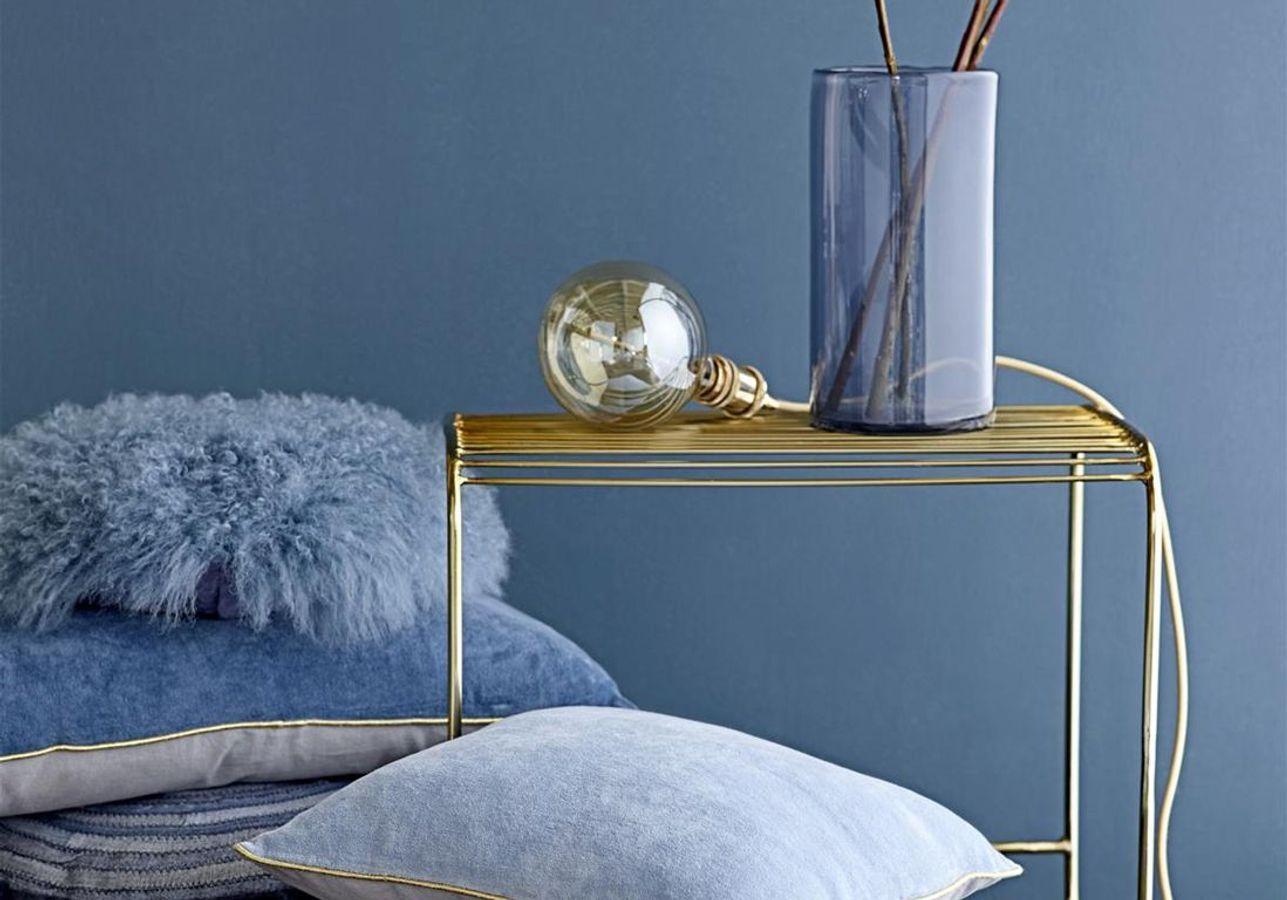 De la petite déco bleue mêlée à du doré pour un rendu élégant