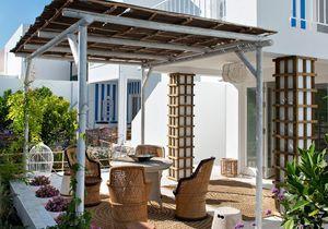 L'enchantement des matériaux naturels de cette maison au Portugal