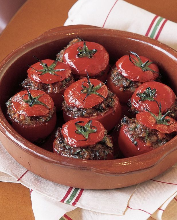 Tomates farcies au confit de canard et aux cèpes