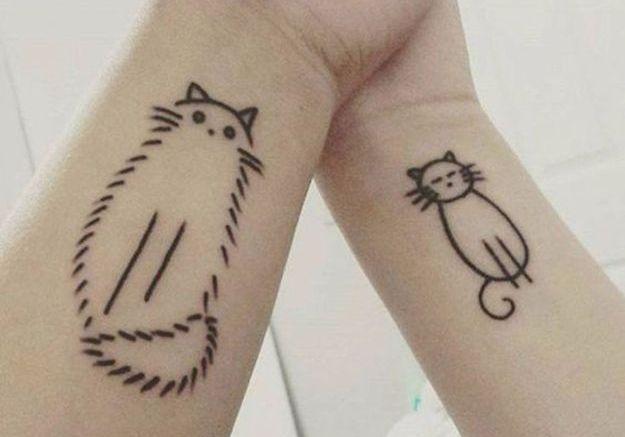 Tatouage chat entre soeur