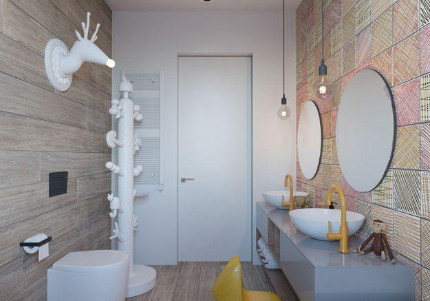 Salle de bains pour enfant avec un carrelage comme des dessins