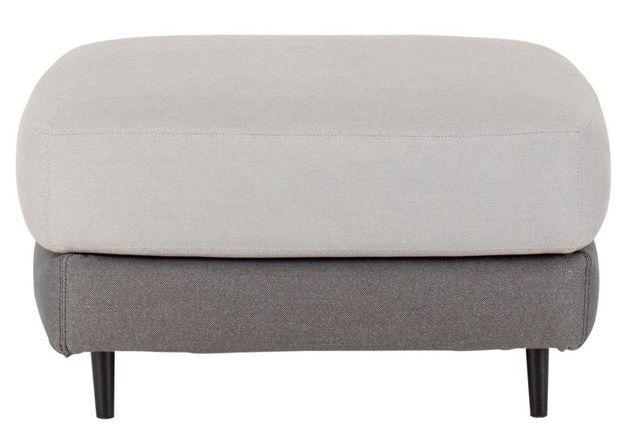 Un canapé gris accompagné d'un repose-pied vintage