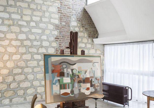 L'atelier avec mur de moellons et briques