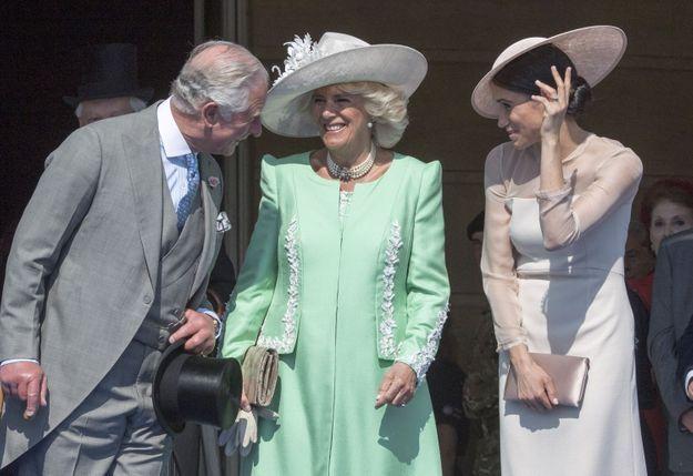 Camilla Parker-Bowles, Meghan Markle et Charles lors de la garden party de mai 2018