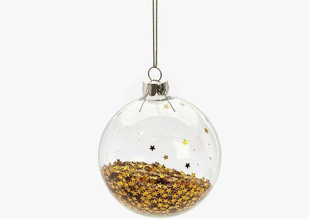 Boule de Noël en verre remplie d'étoiles