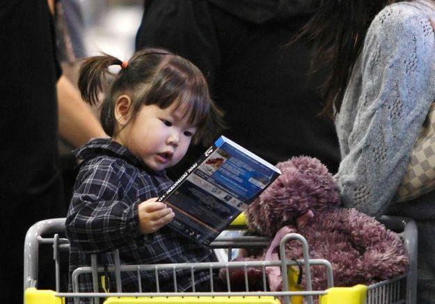 En 2010, dans un supermarché de Los Angeles avec ses parents