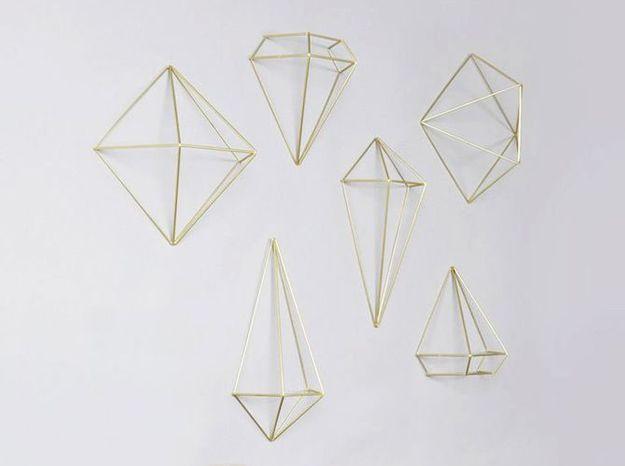 Des décorations murales en laiton façon origami