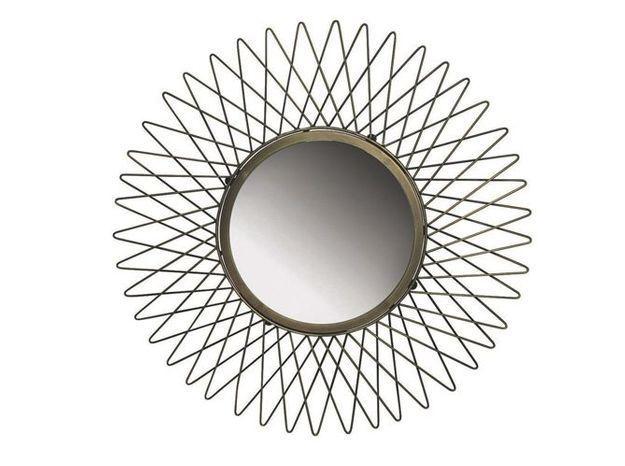 Un miroir vintage en laiton