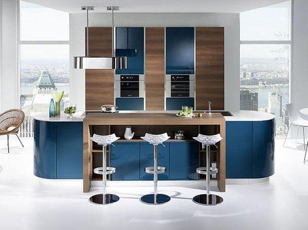 Une cuisine design bleu canard