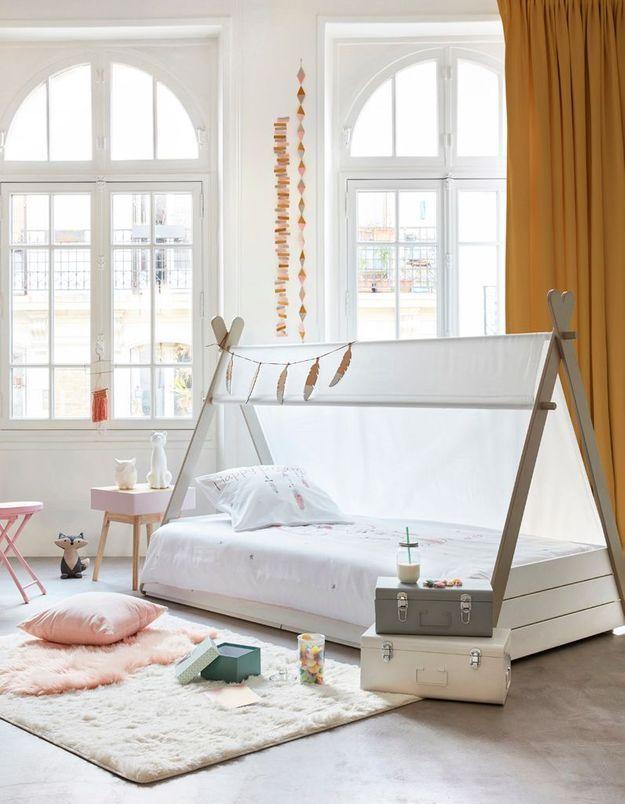 Un lit qui se transforme en espace de jeu