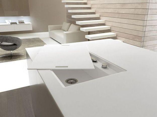 Un îlot qui dévoile une cuisine pour optimiser l'espace