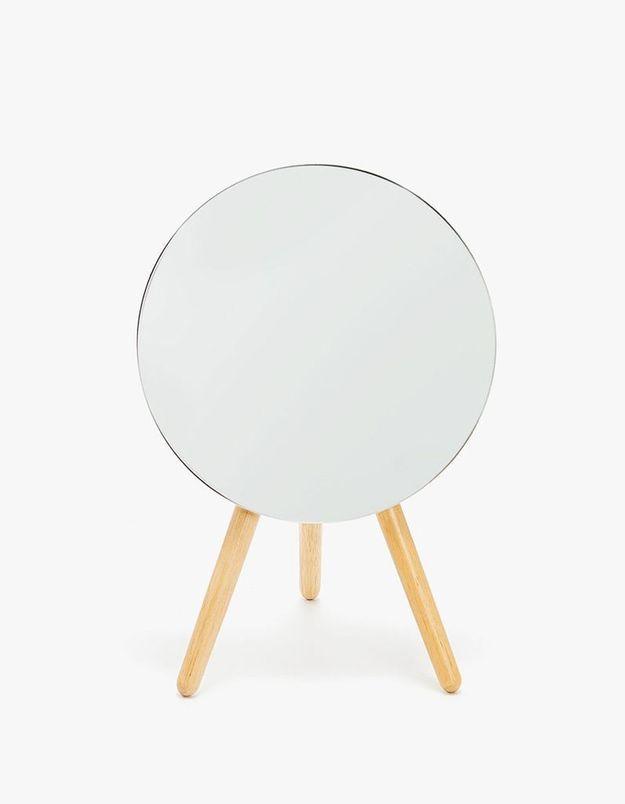 Miroir rond sur pieds