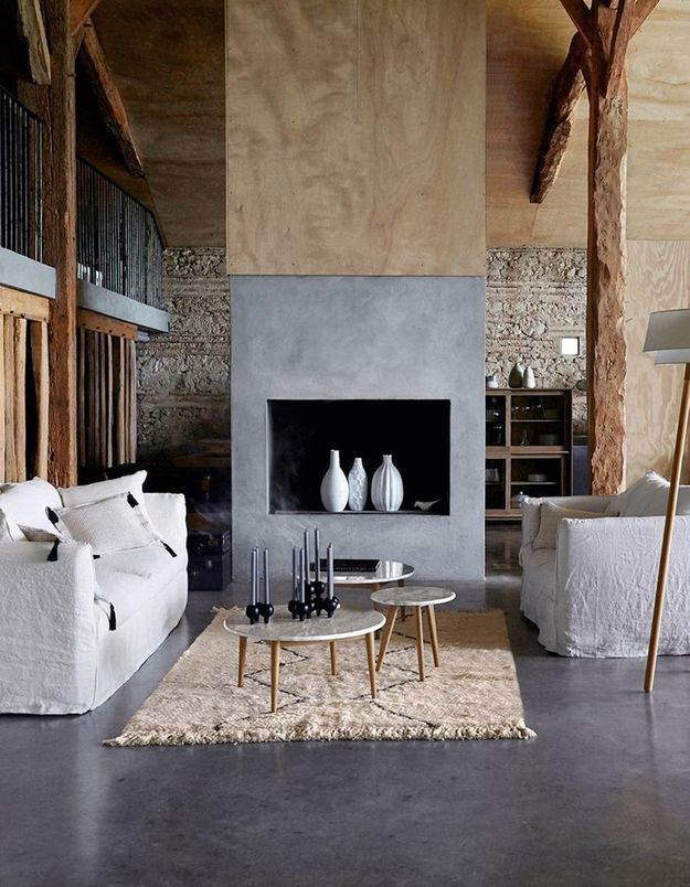 Décorer sa cheminée d'un revêtement effet béton