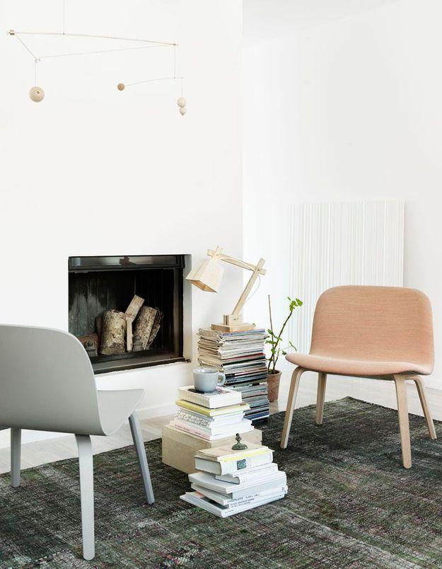 Décorer sa cheminée façon coin lecture cosy