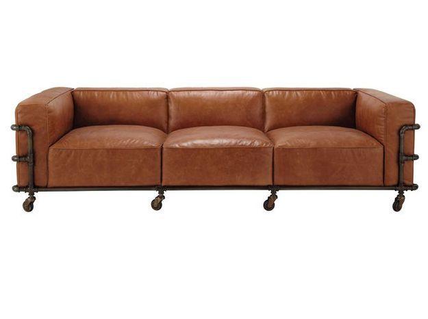 Un canapé en cuir de style industriel