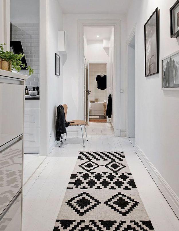 Jouer sur la profondeur via un long tapis dans le couloir