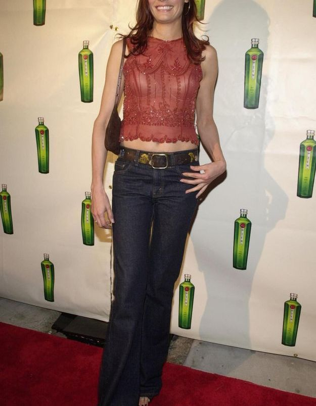 Famke Janssen et son jean brut pattes d'ef', taille basse