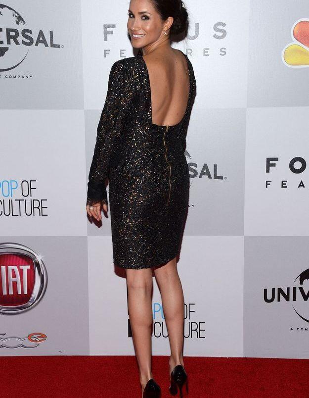 En 2013 elle brille avec une robe dos nu à sequins.