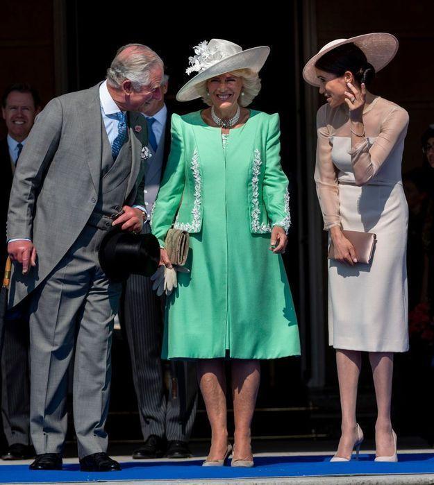 Le prince Charles, Camilla et Meghan Markle, très dissipés