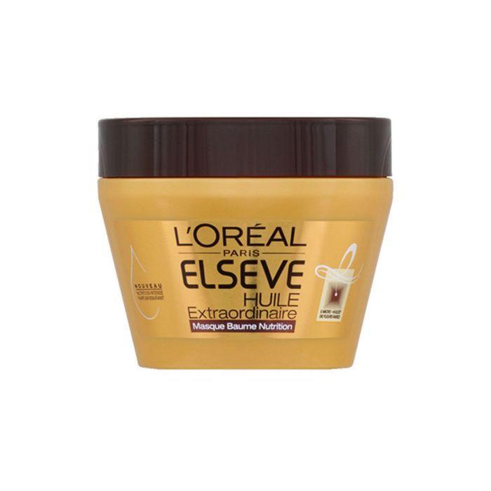 Le masque pour les cheveux de la cannelle et le miel de la photo