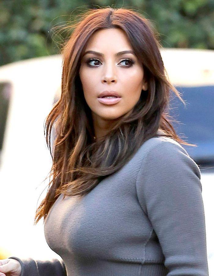 Kim Kardashian, cheveux mi-longs reflets cuivrés en février 2014 - Kim Kardashian : toutes ses ...