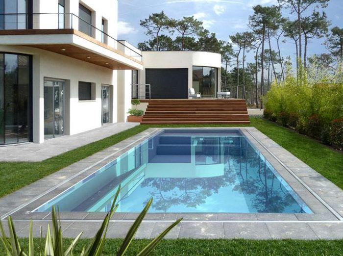 Une piscine pour tous les styles elle d coration for Piscine fond miroir