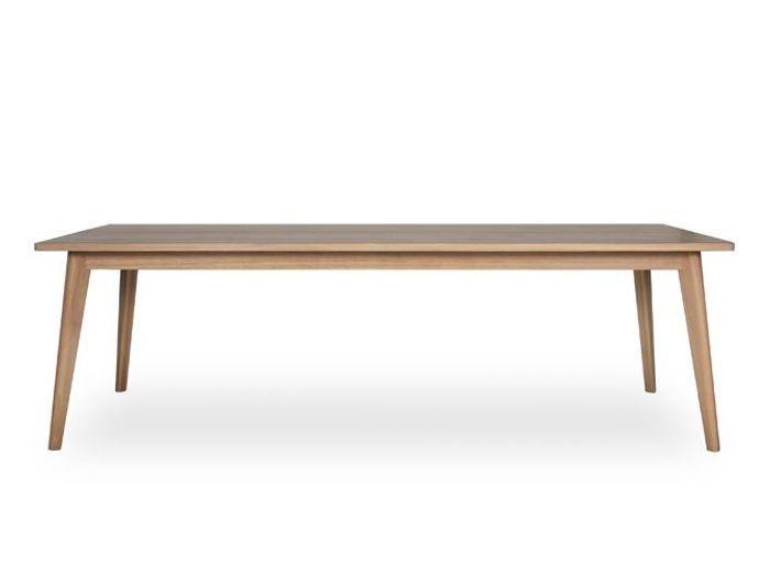 Une grande table en bois au plateau aérien