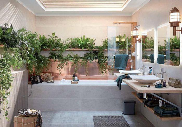 Une gouttière remplie de plantes dans la salle de bains