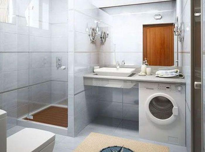 une machine laver sous le plan de travail de la salle de bains - Integrer Machine A Laver Dans Salle De Bain