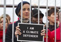 Marion Cotillard en cage pour Greenpeace