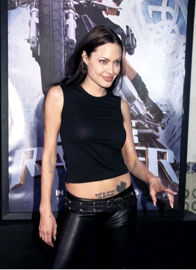 Angelina Jolie and her black cross tattoo