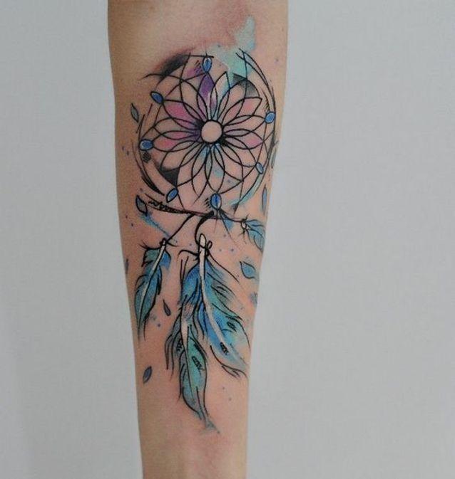 Tatouage aquarelle plume