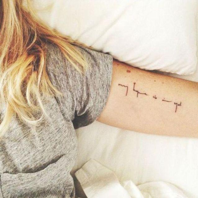 Tatouage bras écriture
