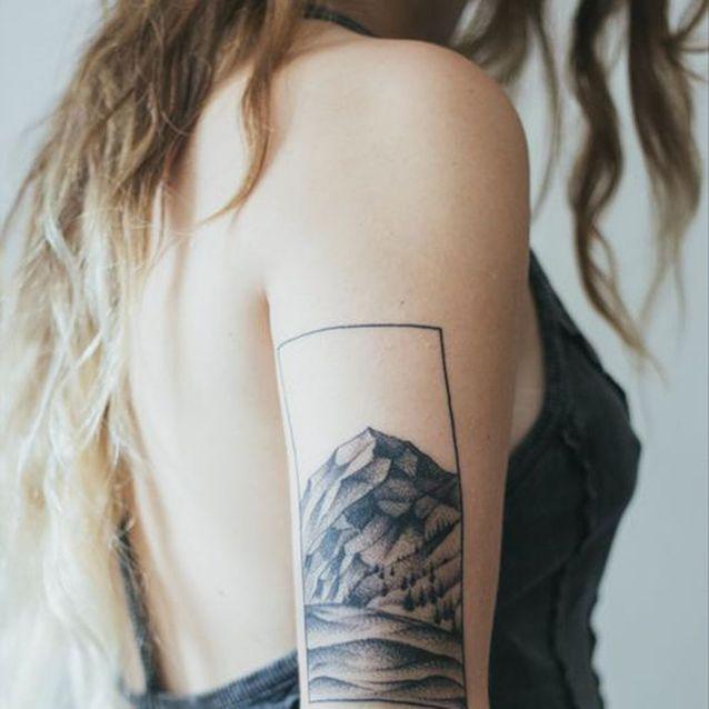Tatouage bras paysage