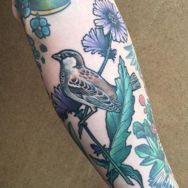 Tatouage oiseau et fleur