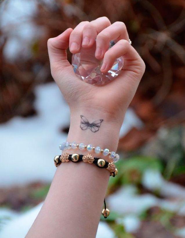 Tatouage papillon avant-bras