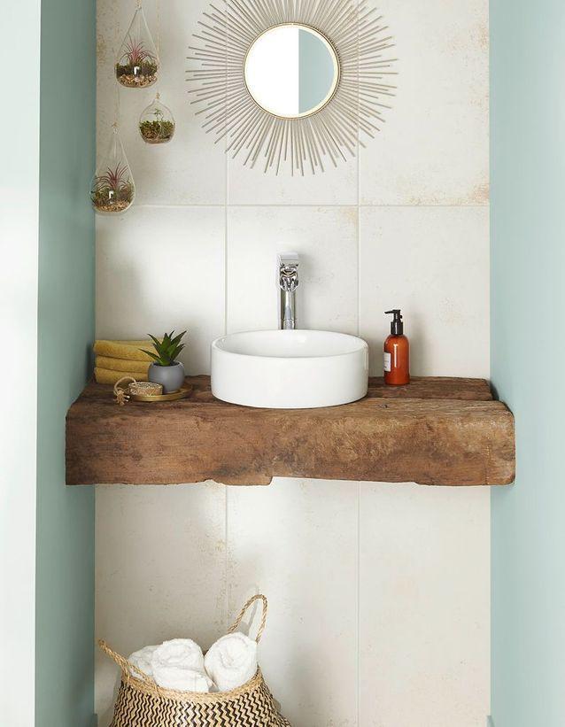 Préférer le bois brut pour une salle de bains zen