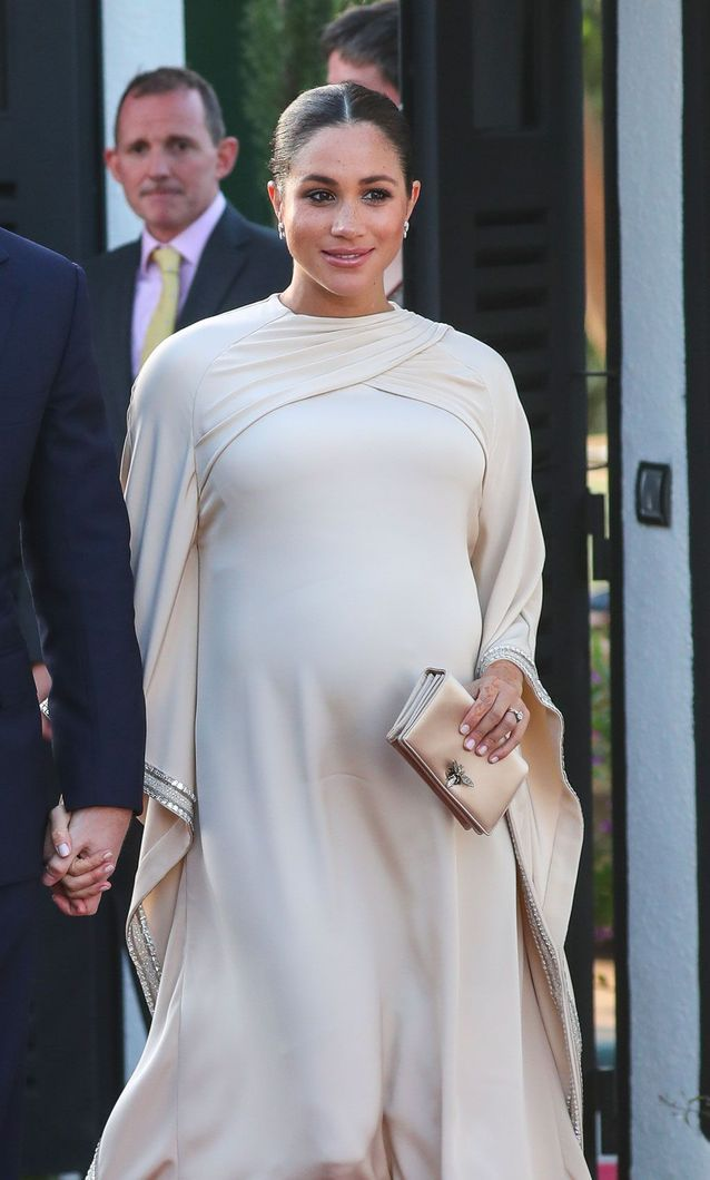 La longue robe blanche de Meghan Markle