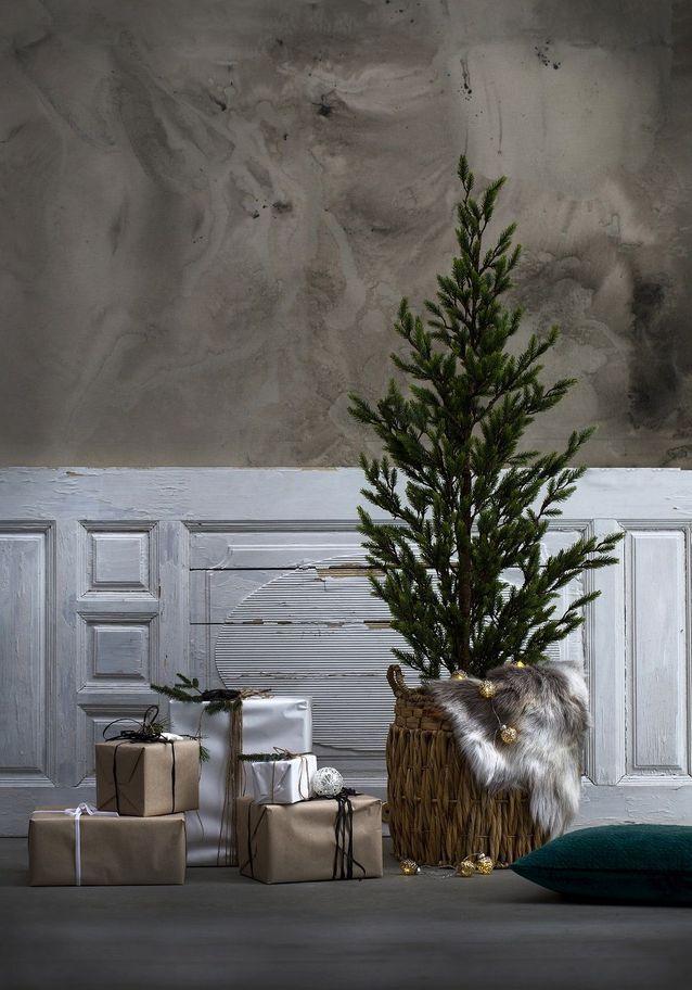 Sapin de Noël avec tapis en fausse fourrure