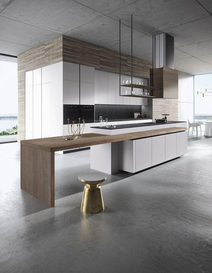 Une cuisine au sol et plafond gris béton