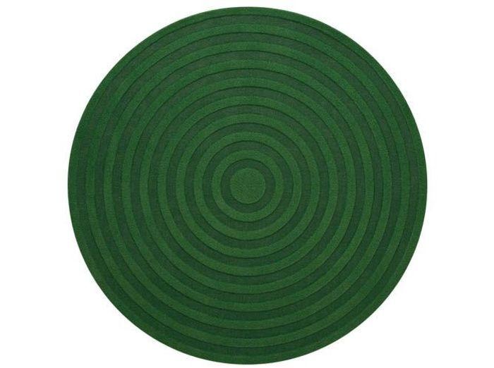 Un tapis rond vert forêt