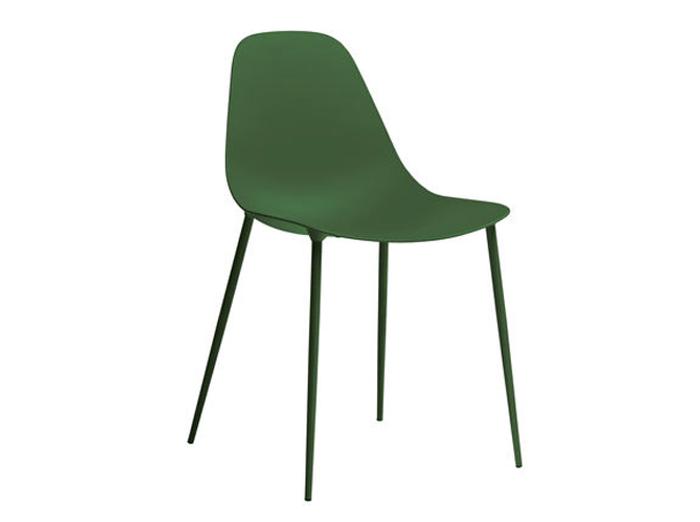 Une chaise aux lignes épurées vert forêt