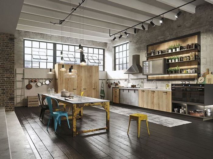 Un loft industriel à la cuisine grandiose