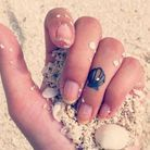 Tatouage doigt coquillage