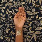 Tatouage doré poignet