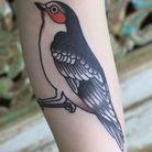 Tatouage oiseau branche