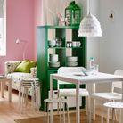La cuisine semi-ouverte via un meuble de rangement