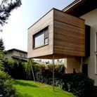 >> Une extension en bois en cube