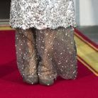 Pour assortir sa tenue, Melania Trump portait des escarpins Louboutin.