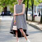 Une fille à lunettes avec une maxi robe